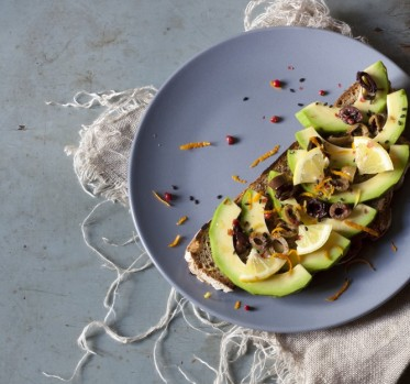 Avocado slices on wholemeal bread vegetarian breakfast